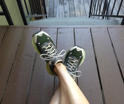 A woman wearing old running shoes for flat feet