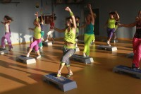 Marina Paraluppi teaching Zumba Step in the gym