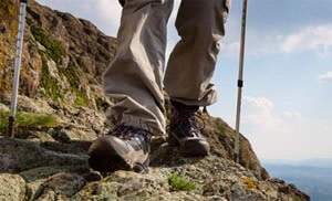 A man hiking through rough mountain terrain