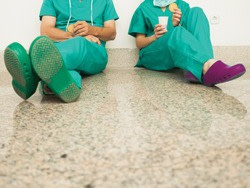 Two nurses sat taking a break