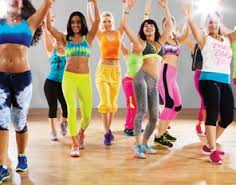 Females wearing vibrant clothes for Zumba