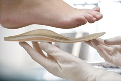 Removable orthopedic insoles for nurses shoes